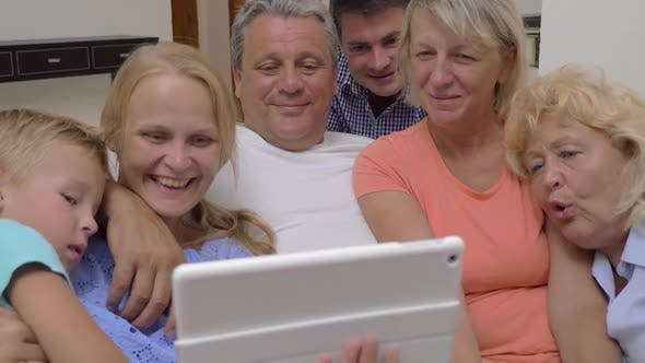 Thumbnail for Big Family Watching Video on Digital Tablet