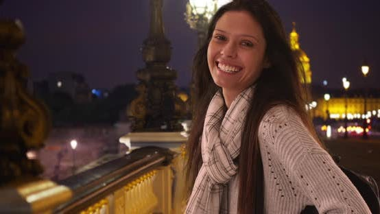 Thumbnail for Tourist woman in striped scarf smiling at camera on Pont Alexandre III bridge