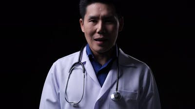 Doctor posing and looking at camera with speech presentation data