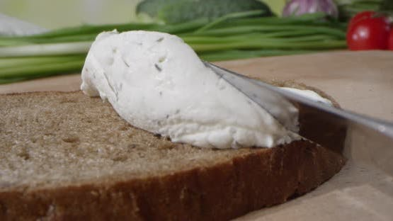 Creamy Textured Paste With Dill Is Spreading On The Toast Of Bread With Butter Knife