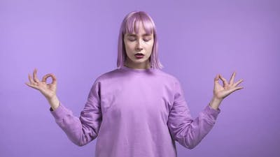 Calm Woman with Dyed Purple Hair Relaxing Meditating
