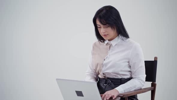 Thumbnail for Beautiful woman is typing on a laptop