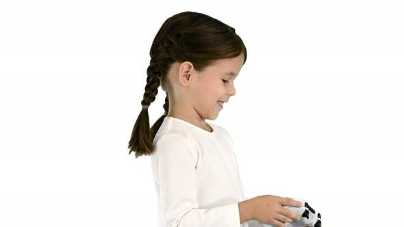 Smiling Little Girl Play Videogame Holding Joystick in Her Hands on White Background