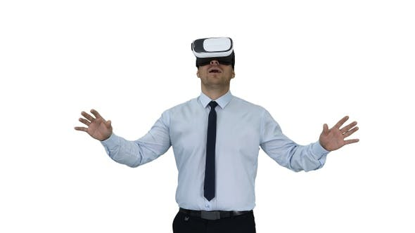 Astonished young businessman wearing VR glasses Concept