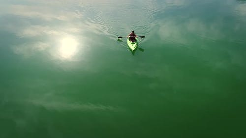 Aerial view of a kayaker on Hatta lake in Dubai.