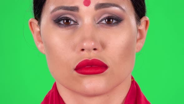 Thumbnail for Portrait of Beautiful Indian Girl Is Looking at the Camera with Very Upset and Offended Face