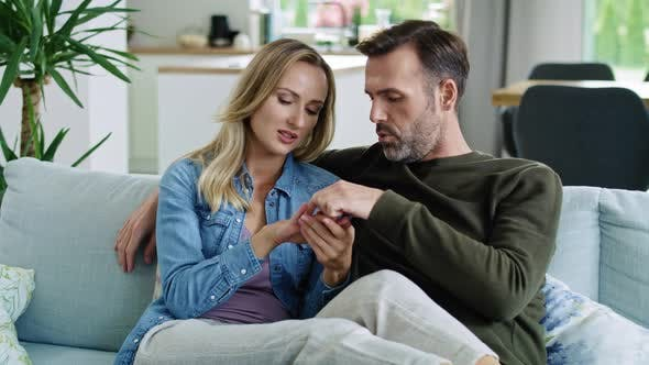 Thumbnail for Mature couple talking about wedding ring