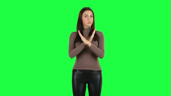 Thumbnail for Attractive Girl Strictly Gesturing with Hands Crossed Making X Shape Meaning Denial Saying NO. Green