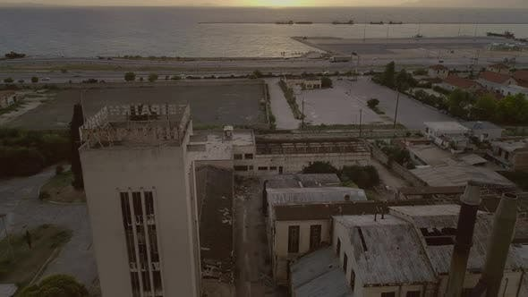 Aerial view of a abandoned area and building located nearby the sea in Patras.