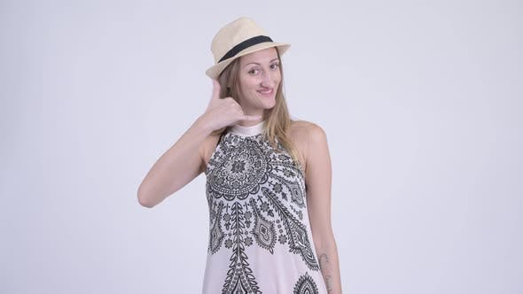 Cover Image for Portrait of Happy Blonde Tourist Woman with Call Me Gesture