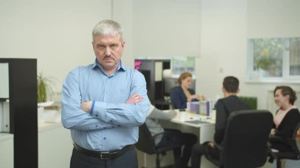 Thumbnail for Working Day in the Office, Unkind Man Stand and Look at Camera