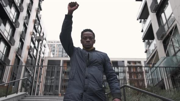 African American Man Holding Up Hand at Demonstration Protest