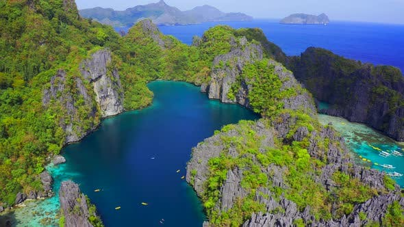Thumbnail for Rocky Mountains with Big Lagoon on Background Turquoise Ocean in El Nido, Palawan, Philippines