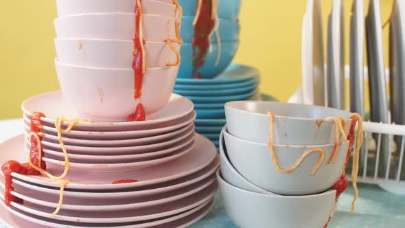 Thumbnail for Pile of Dirty Colorful Kitchenware in Yellow Background.