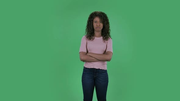 Thumbnail for Portrait of Beautiful African American Young Woman Is Looking at Camera Is Very Offended and Shrugs