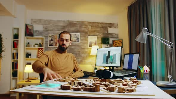 Thumbnail for Architect in Home Office Working in Augmented Reality Placing Buildings in City
