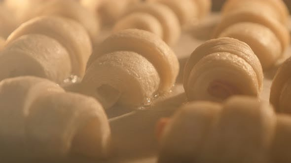 Thumbnail for Homemade basic dough rolls in the oven slow tilting 4K 2160p UltraHD footage - Rolls slow baking in