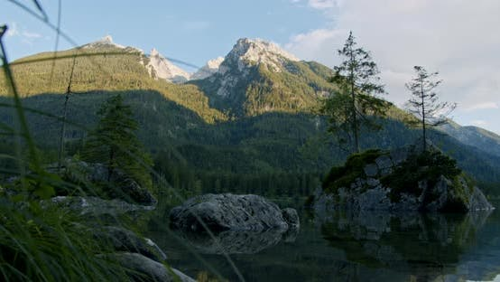 Thumbnail for Hintersee Lake, Stones and Fir Trees in Dusk Blue Hour. Ramsau, Berchtesgaden, Bavaria, Germany