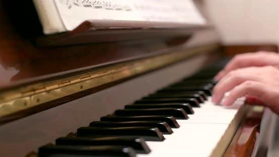 Thumbnail for Man practicing piano at home