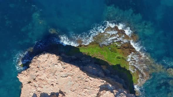 Thumbnail for Aerial View. Ocean with Waves and Rocky Cliff.