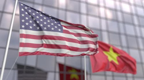 Waving Flags of the United States and Vietnam