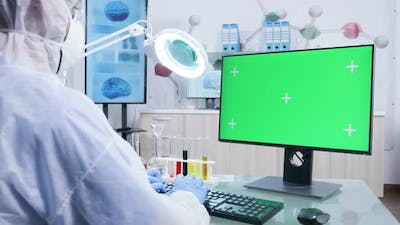 Static Shot of Scientist Working with a Green Screen PC