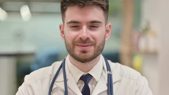 Thumbnail for Cheerful Young Doctor Smiling at the Camera