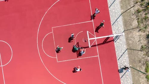 Aerial View of Young Athletes Throwing the Ball Into the Basketball Basket