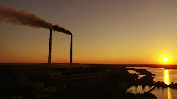Thumbnail for Harmful factory among nature at sunset