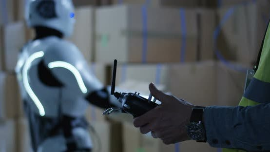 Thumbnail for Man Controlling a Robot