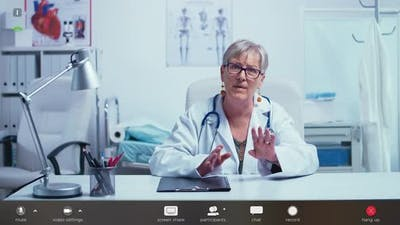 Authentic Senior Doctor Making an Online Consultation Via Zoom Call