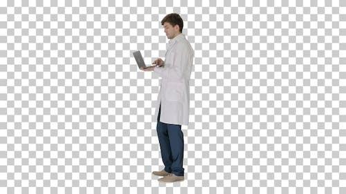 Male doctor in white coat having video, Alpha Channel