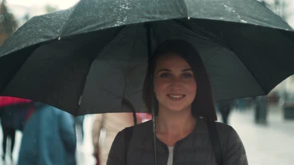 Portrait of Smiling Woman Under Umbrella in Rain. Tourist Girl Under Umbrella in Rain