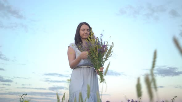 Thumbnail for Florist Woman With Bouquet Of Field Flowers