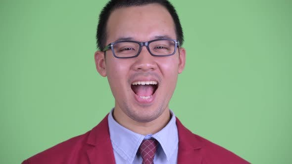 Cover Image for Face of Happy Asian Businessman with Eyeglasses Smiling