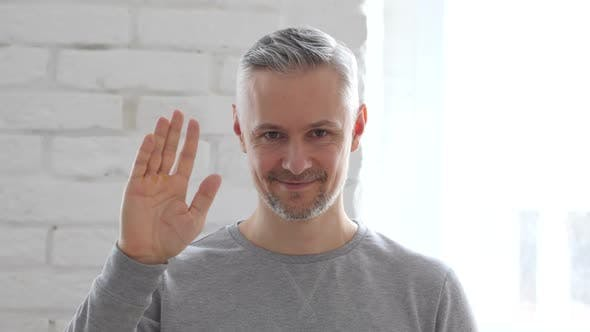 Thumbnail for Hello, Middle Aged Man Waving Hand