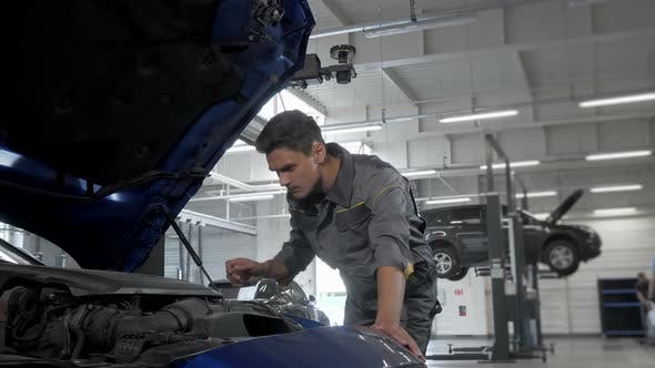 Thumbnail for Car Service Technician Checking Oil in Automobile with Open Hood