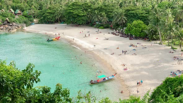 Cover Image for Aerial view of sandy beach with people in sea bay with transparent blue water in summer