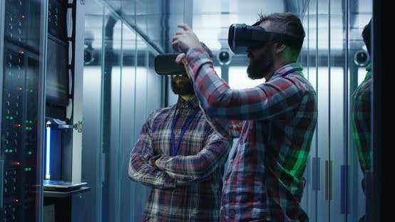 Thumbnail for IT Engineers Using VR Glasses in Server Room