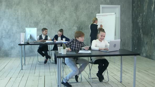 Cover Image for Little Business Kids Working in Office, Using Flipchart, Discussing Problems