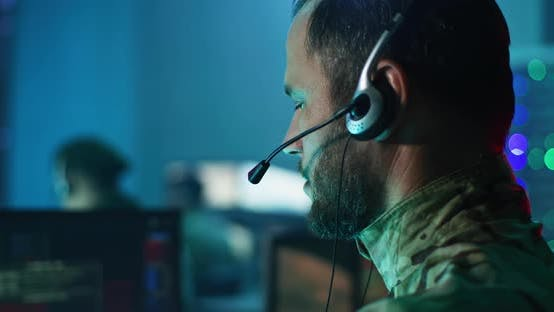 Military Man Giving Commands in Control Center