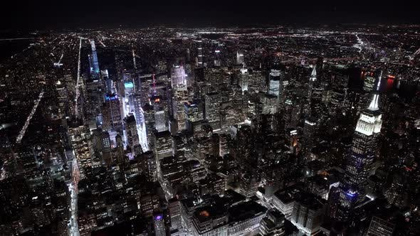 Thumbnail for Wide angle view of the Empire State Building at Night as seen from a helicopter