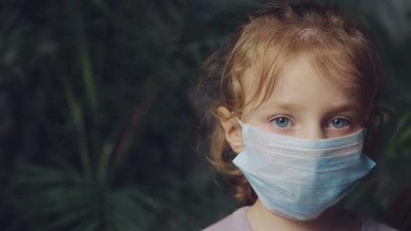 Thumbnail for Little Girl in a Medical Mask.
