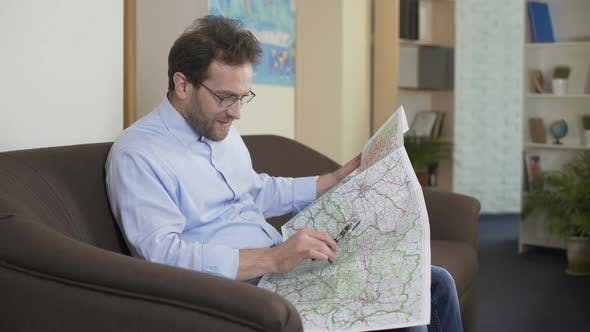 Thumbnail for Globetrotter Planning Trip, Adult Man Looking at Map, Vacation and Traveling