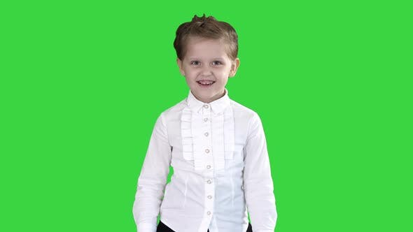 Thumbnail for Little Girl Walking and Smiling on a Green Screen, Chroma Key