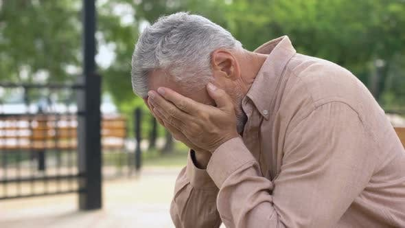 Thumbnail for Sad Old Man Sitting on Hospital Garden Bench, Pensioner Crying in Sorrow