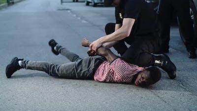 Police Officers Arresting Black Man