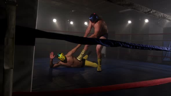 Masked wrestler attempts to tap out