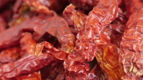 Thumbnail for Tilting on red  Capsicum peppers before being processed into powder 4K video