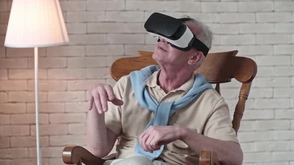 Thumbnail for Elderly Man in Rocking Chair Wearing VR Headset